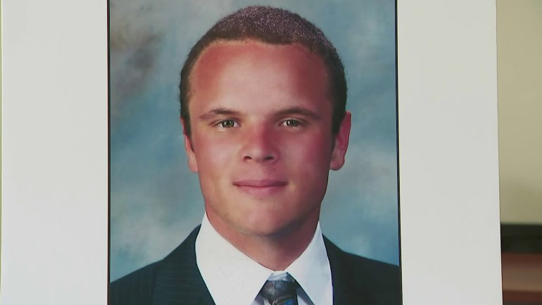 A photo of Cole Micek was displayed at a news conference where authorities announced a reward for information leading to the arrest of two hit-and-run drivers who fatally struck him on March 3, 2018. (Credit: KTLA)