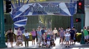 Disneyland patrons exit the park under the Disneyland sign at a shuttle area in Anaheim in 2017. (Credit: Allen J. Schaben / Los Angeles Times)