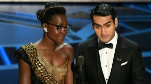 Kenyan-Mexican actress Lupita Nyong'o and Pakistani-American stand-up comedian Kumail Nanjiani present the  Oscar for Best Production Design during the 90th Annual Academy Awards show on March 4, 2018 in Hollywood. (Credit: MARK RALSTON/AFP/Getty Images)