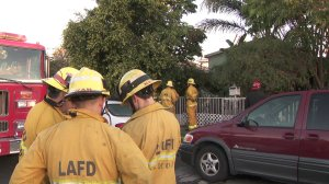 Los Angeles firefighters are shown at the scene of a fatal fire in Wilmington on March 18, 2018. (Credit: KTLA)