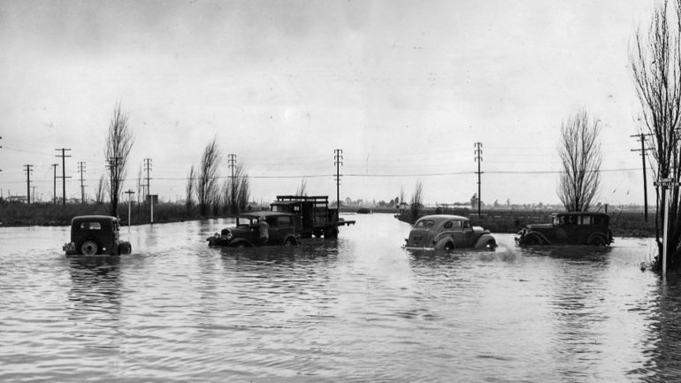 Autos stall in flooded Fox Hills Boulevard and Slauson Avenue after a storm brought about 4 inches of rain. This photo was published in the L.A. Times on March 1, 1938.