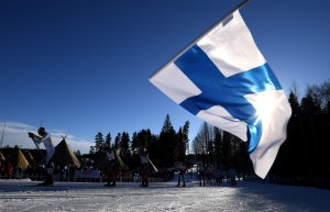A Finland flag is waved as the skiers compete in the Men's Cross Country Skiathlon during the FIS Nordic World Ski Championships on February 25, 2017 in Lahti, Finland. (Credit: Matthias Hangst/Getty Images)