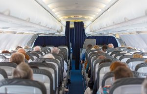 Commercial aircraft cabin with passengers. (Credit:  iStock / Getty Images Plus)