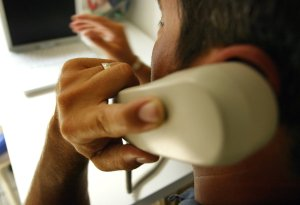 A man makes a phone call in this file photo. (Credit: Spencer Platt/Getty Images)