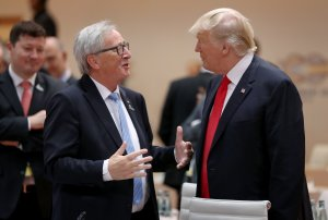 U.S. President Donald Trump, right, and European Commission President Jean-Claude Juncker chat at the G20 economic summit on July 8, 2017 in Hamburg, Germany. (Credit: Sean Gallup/Getty Images)