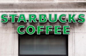 A logo is pictured above a Starbucks coffee shop in this file photo. (Credit: JUSTIN TALLIS/AFP/Getty Images)
