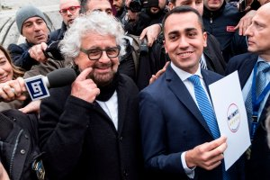 Five Star Movement leader Luigi Di Maio, right, poses with movement founder Beppe Grillo outside the Interior Ministry on Jan. 19, 2018 after they registered their logo for the upcoming general elections to be held on March 4, 2018. (Credit: ANDREAS SOLARO/AFP/Getty Images)