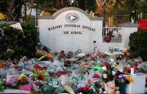 Flowers, candles and mementos sit outside one of the makeshift memorials at Marjory Stoneman Douglas High School in Parkland, Fla., on February 27, 2018. (Credit: RHONA WISE/AFP/Getty Images)