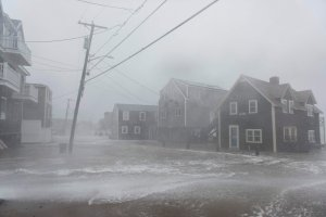 Coastal areas in New England are bracing for the high tide that is scheduled to be at its highest as waves crash into homes in Scituate, Massachusetts on March 2, 2018. (Credit: RYAN MCBRIDE/AFP/Getty Images)