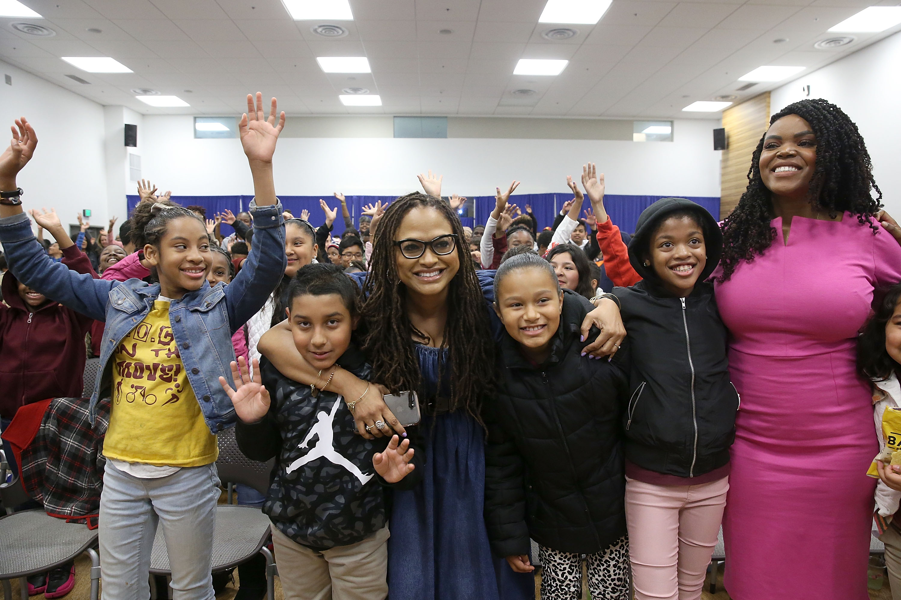 """Director Ava DuVernay and Compton Mayor Aja Brown attend a special advance private screening of """"A Wrinkle in Time"""" attended by students from various middle schools around the city of Compton on March 2, 2018. (Credit: Jesse Grant/Getty Images for Disney)"""