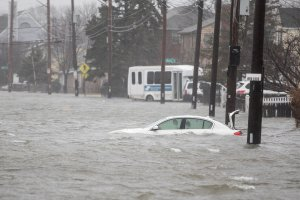 A flooded car sits in Hough's Neck due to a strong coastal storm on March 2, 2018 in Quincy, Massachusetts. (Credit: Scott Eisen/Getty Images)