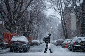 A man walks through the Boerum Hill neighborhood in Brooklyn during a snowstorm, March 7, 2018, in New York City. (Credit: Drew Angerer/Getty Images)