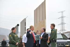 President Donald Trump inspects border wall prototypes in San Diego on March 13, 2018. (Credit: MANDEL NGAN/AFP/Getty Images)