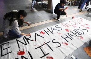 Young activists paint signs to be carried at the upcoming March for Our Lives Los Angeles on March 22, 2018 in Los Angeles, California. (Credit: Mario Tama/Getty Images)