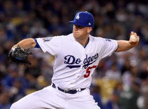 Alex Wood of the Los Angeles Dodgers pitches in the third inning of the game against the San Francisco Giants at Dodger Stadium on March 30, 2018. (Credit: Jayne Kamin-Oncea/Getty Images)