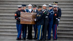 A military honor guard carries the casket of Rev. Billy Graham out of the U.S. Capitol on March 1, 2018. (Credit: Tasos Katopodis-Pool/Getty Images)