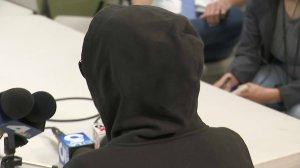"""A woman LAPD identified as """"Jane Doe"""" speaks to reporters on March 29, 2018. (Credit: KTLA)"""