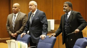 """Attorney Matthew Fletcher, left, represented by Mark J. Geragos, center, and attorney Thaddeus Culpepper appear in court as they were indicted on charges of conspiring to bribe potential witnesses in the pending murder case of former rap mogul Marion """"Suge"""" Knight. (Credit: Al Seib / Los Angeles Times)"""
