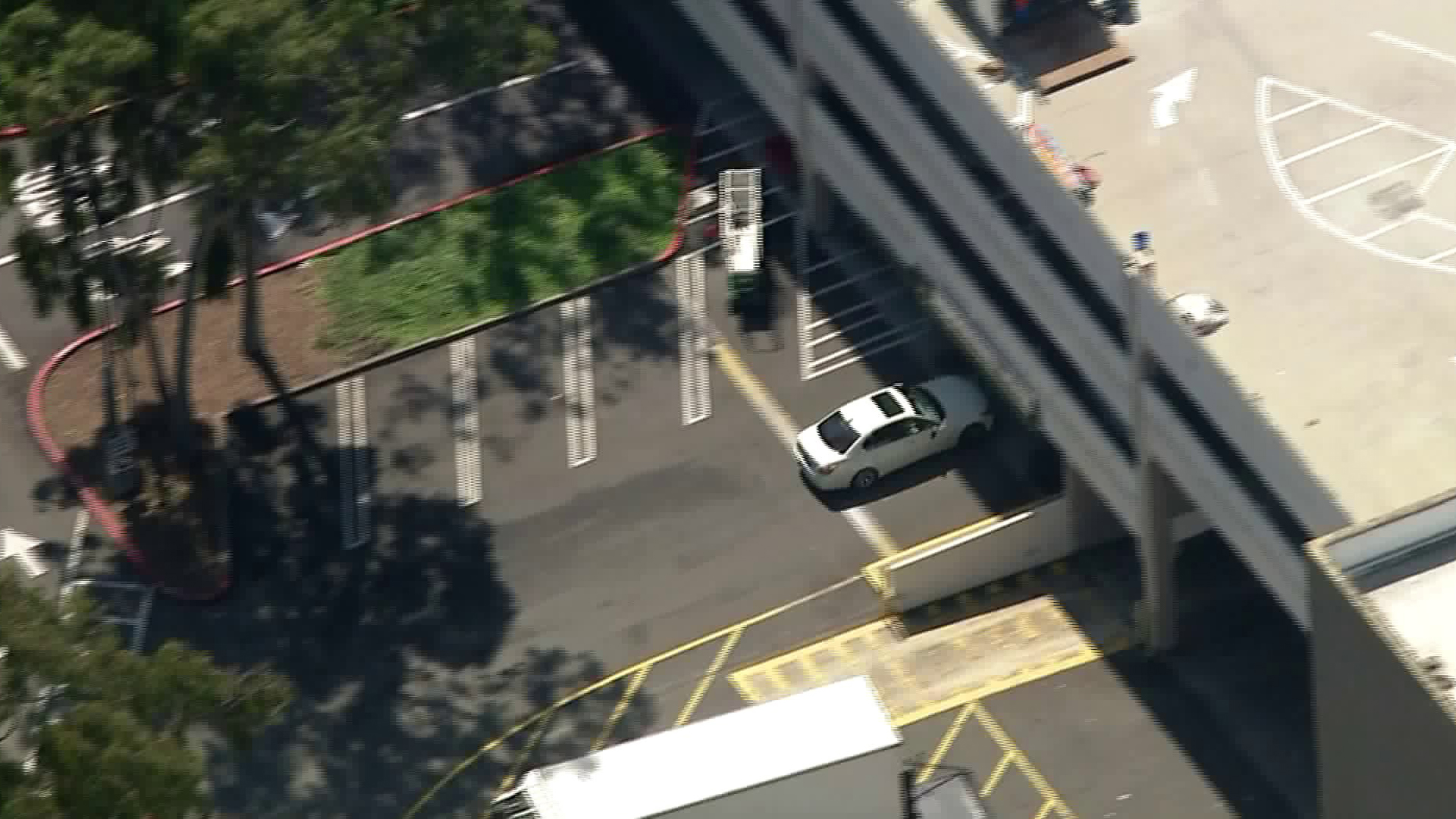 A driver who led police on a pursuit from the San Fernando Valley to West L.A. drives into the parking structure of the Westfield Culver City shopping mall on March 23, 2018. (Credit: KTLA)