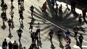 Participants run along Hollywood Boulevard during the L.A. Marathon on March 18, 2018. (Credit: Wally Skalij / Los Angeles Times)