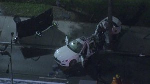 A Maserati appears to be split in half and badly damaged after the driver crashed into a tree in Long Beach on March 16, 2018. (Credit: KTLA)