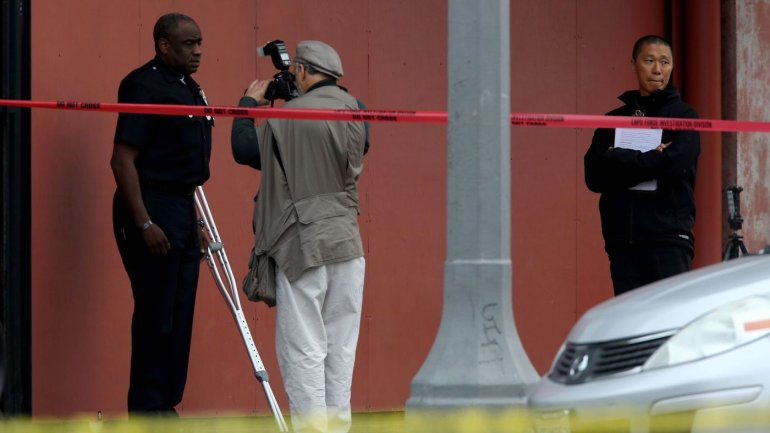 An investigator photographs then-LAPD Officer Clifford Proctor after he shot and killed Brendon Glenn, 29, near the Venice boardwalk. (Credit: Irfan Khan/Los Angeles Times)