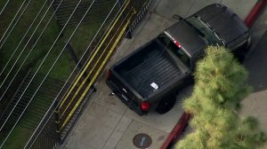 A truck sits on the pavement outside Paramount High School after five students were struck there on March 19, 2018. (Credit: KTLA)