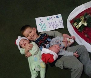 Michael Demasi Jr. pose with his 4-month-old twin brothers, who have chronic granulomatous disease, in this undated photo. (Credit: Robin Pownall/CNN)