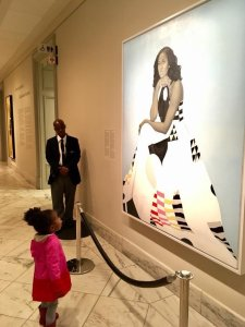 Parker Curry, 2, looks at a portrait of former first lady Michelle Obama at the National Portrait Gallery in Washington D.C. on March 1, 2018. (Credit: Ben Hines)