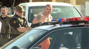 A man is seen being taken into custody after a pursuit extending from San Clemente to Santa Ana on March 6, 2018. (Credit: KTLA)