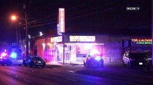 A suspected burglar died in police custody Sunday night in Santa Ana. (Credit: OnScene.TV)