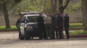 Officials convene at the scene of a deputy-involved shooting in South El Monte on March 18, 2018. (Credit: KTLA)