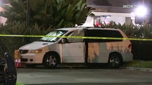 The bodies of four people were found inside a van in Garden Grove on March 16, 2018. (Credit: KTLA)