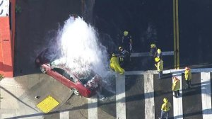 A car involved in a police pursuit crashed into a fire hydrant in South Los Angeles on March 27, 2018. (Credit: KTLA)