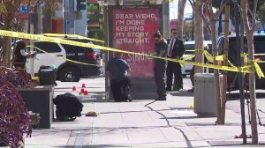 Investigators look through the scene in West Hollywood where a man was fatally stabbed on March 4, 2018. (Credit: KTLA)