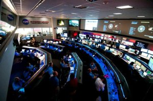 """The mission control room at JPL -- the Space Flight Operations Facility - is also referred to as """"the center of the universe."""" It's one of the more popular places for visitors to check out during the """"A Ticket to Explore JPL"""" event. (Credit: NASA/Jet Propulsion Laboratory-Caltech)"""