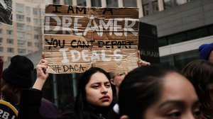 Demonstrators, many of them recent immigrants to America, protest the government shutdown and the lack of a deal on Deferred Action for Childhood Arrivals outside of Federal Plaza on Jan. 22, 2018, in New York City. (Credit: Spencer Platt/Getty Images)