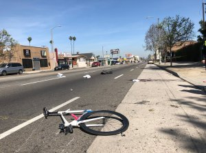 The scene where bicyclist was killed by a Porsche driver in a hit-and-run in South L.A. is seen in a photo shared by Los Angeles police on April 10, 2018.
