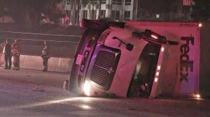 A big rig toppled on the 210 Freeway and blocked the nearby Metro tracks in Pasadena on April 26, 2018. (Credit: KTLA)