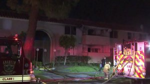 The scene of a fire at an apartment complex in Anaheim on April 14, 2018, is seen here. (Credit: KTLA)