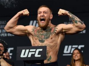 UFC featherweight champion Conor McGregor poses on the scale during his weigh-in for UFC 202 at MGM Grand Conference Center on Aug. 19, 2016, in Las Vegas. (Credit: Ethan Miller / Getty Images)