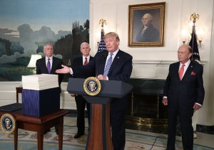 Donald Trump speaks to the press about the $1.3 trillion spending bill passed by Congress on March 23, 2018. (Credit: Mark Wilson/Getty Images)