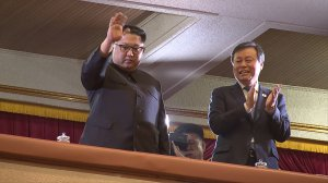 This picture captured from a video footage by Korea Pool reporters shows North Korean leader Kim Jong Un (left) and South Korea's Culture, Sports and Tourism Minister Do Jong-whan (right) during a rare concert by South Korean musicians at the 1,500-seat East Pyongyang Grand Theatre in Pyongyang on April 1, 2018. (Credit: AFP/ Getty Images/KOREA POOL)
