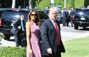 US President Donald Trump and First Lady Melania Trump arrive for Easter service at the Church of Bethesda-by-the-Sea in Palm Beach, Florida, April 1, 2018. (Credit: NICHOLAS KAMM/AFP/Getty Images)