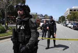 Law enforcement stands watch outside of the YouTube headquarters on April 3, 2018 in San Bruno. (Credit: Justin Sullivan/Getty Images)