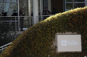 Police officers stand by in front of the YouTube headquarters on April 3, 2018 in San Bruno. (Credit: Justin Sullivan/Getty Images)