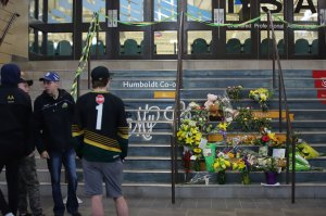 Flowers are left outside the Humboldt Uniplex ice-skating rink on April 7, 2018 in Humboldt, Saskatchewan after a bus carrying a junior ice hockey team collided with a semi-trailer truck near Tisdale and Nipawin, Saskatchewan province. (Credit: KYMBER RAE/AFP/Getty Images)