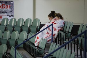 Two girls sit amid empty seats of the Humboldt Uniplex ice-skating rink on April 7, 2018, in Humboldt, Canada, after a bus carrying a junior ice hockey team collided with a semi-trailer truck near Tisdale and Nipawin. (Credit: Kymber Rae / AFP / Getty Images)