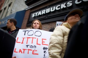 Protestor Soren Mcclay, 14, demonstrates outside a Center City Starbucks on April 15, 2018 in Philadelphia, Pennsylvania. Police arrested two black men who were waiting inside, which prompted an apology from the company's CEO. (Credit: Mark Makela/Getty Images)