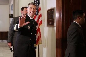 Physician to the President U.S. Navy Rear Admiral Ronny Jackson waves to journalists as he heads into a meeting with Senate Veterans Affairs Committee Chairman Johnny Isakson (R-GA) in the Russell Senate Office Building on Capitol Hill April 16, 2018, in Washington, D.C. (Credit: Chip Somodevilla/Getty Images)